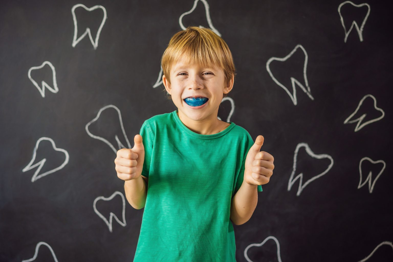 six year old boy shows myofunctional trainer. helps equalize the growing teeth and correct bite, develop mouth breathing habit. corrects the position of the tongue