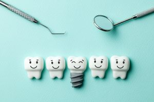 healthy white teeth and implants are smiling against green mint background and dentist tools mirror, hook.